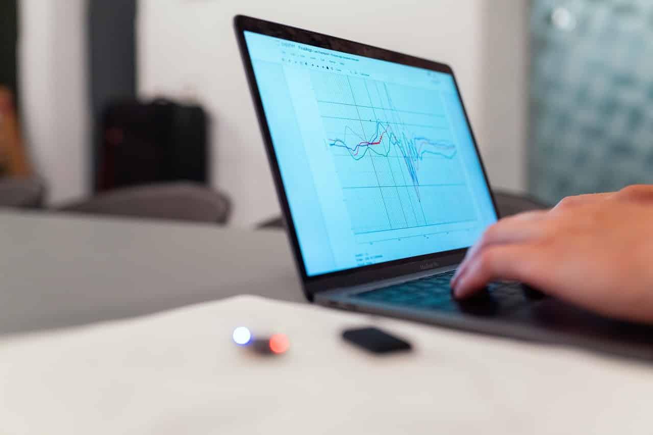 Hands working on big data analysis